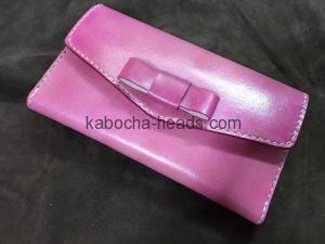 ピンクのリボン付きスマホケース1